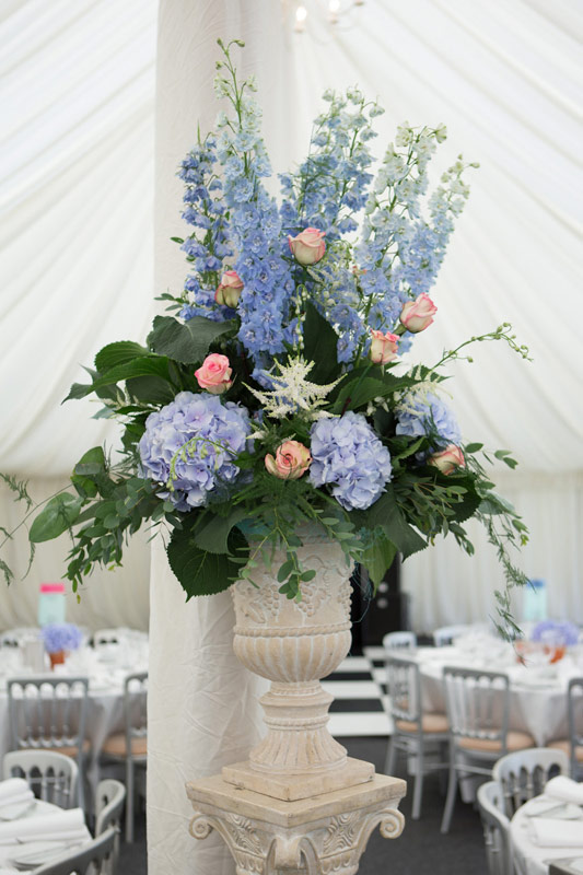 Blue Delphiniums and Hydrangea wedding flowers arranged in an urn