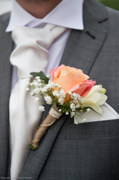 Groom's button hole with Miss Piggy Rose and Gypsophila