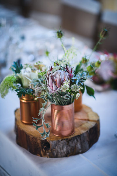 Table Centrepiece with Protea in copper tins