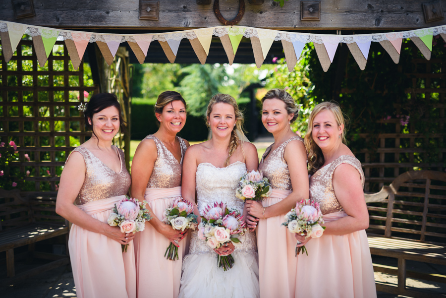 Bride and Bridesmaids holding bouquets with Proteas