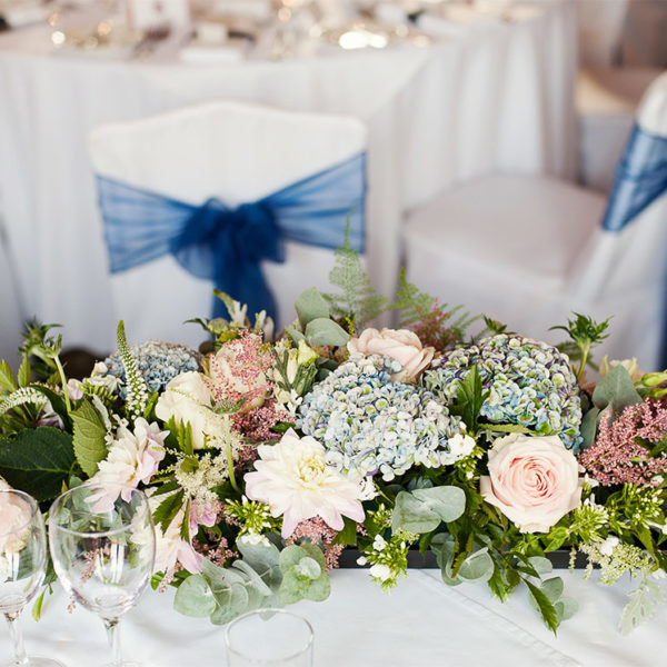 Top table flowers for a navy themed wedding