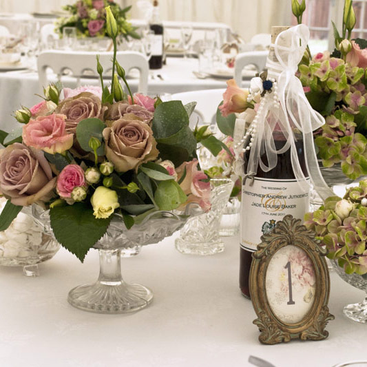 Vintage wedding reception flowers in deep dusky pinks