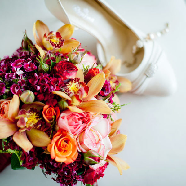 Tropical coloured bridal bouquet with orchids
