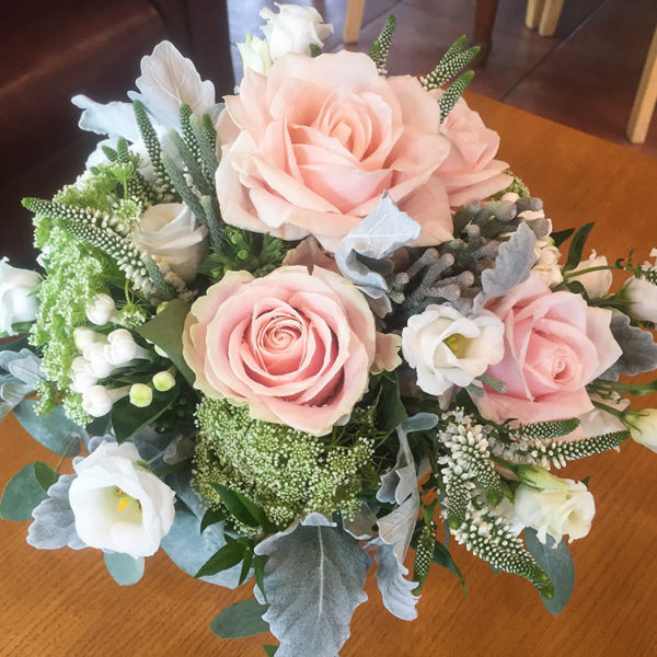 Veronica accents this bridal bouquet
