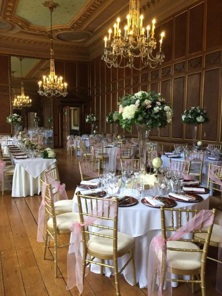 Tall vase table centrepieces at Gosfield Hall